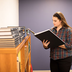 student looking through archives